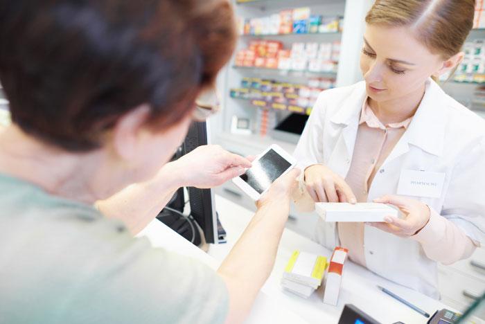 photo of a pharmacist helping customer