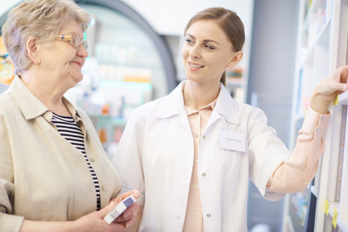 photo of a pharmacist helping patient